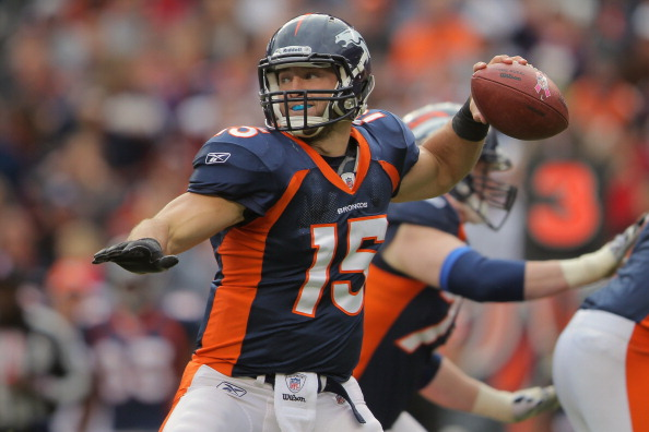 Quarterback Tim Tebow #15 of the Denver Broncos delivers a pass