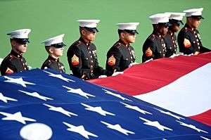 United States Marines hold a giant American Flag