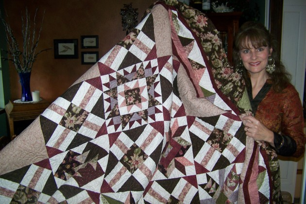 Jenny Harding with the quilt she made