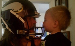 Man in his Vikings Helmet with Grandson