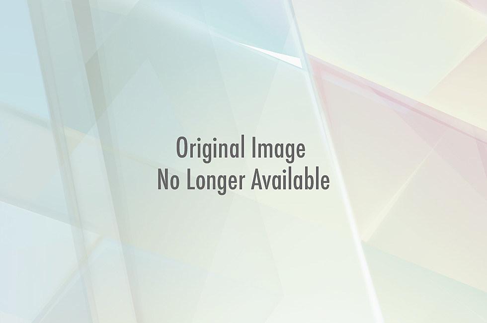 girl with large knitting needles