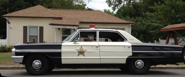 Mayberry police car in front of Andy Griffith boyhood home in Mt Airy, NC