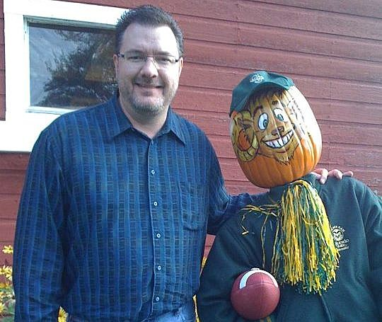 Todd Harding with Pumpkin Scarecrow - Friday at the Farm 2011