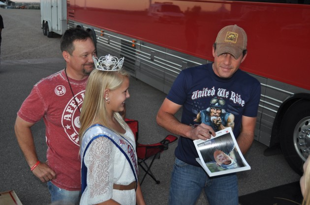Rodney Atkins signs autograph in front of his tour bus