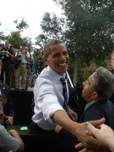 President Obama shakes hands at CSU rally