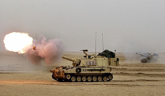U.S. Soldiers Fire 155MM Shell