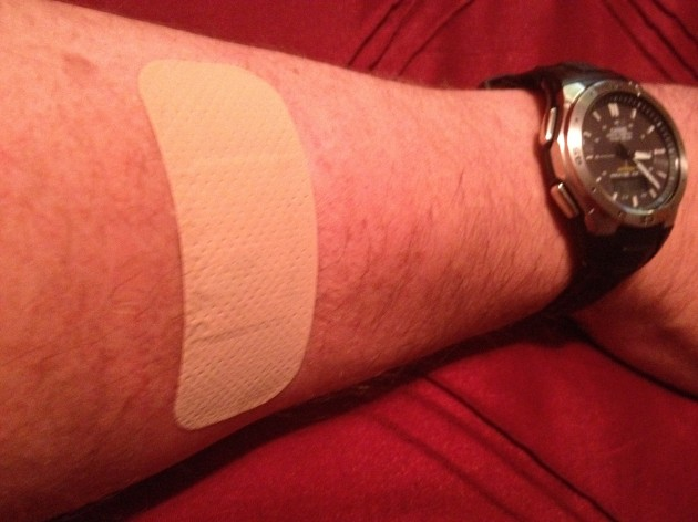 Man's arm with Bandaid