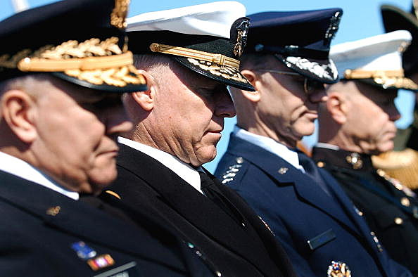 Army Gen. Richard Cody, Adm. Robert F. Willard, Air Force Gen. John D.W. Corley and Marine Lt. Gen. James F. Amos, representing the individual branches of the armed forces
