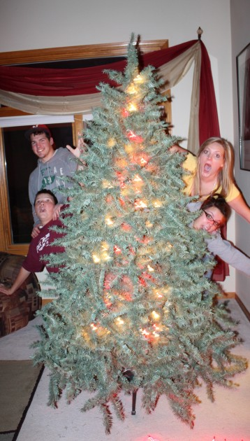 D Dennison kids after decorating Christmas Tree