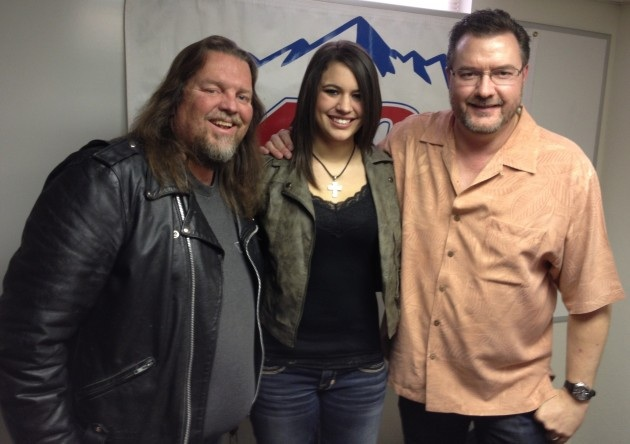 Todd in salmon-colored shirt with Brian Gary and Rachel Farley
