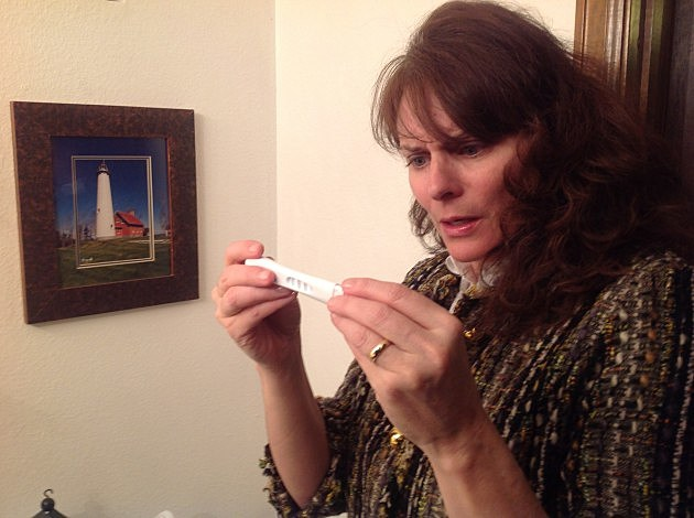 Todd's wife Jenny checks results of home pregnancy test