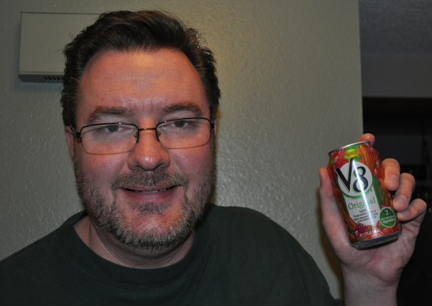 Todd holding a can of V8