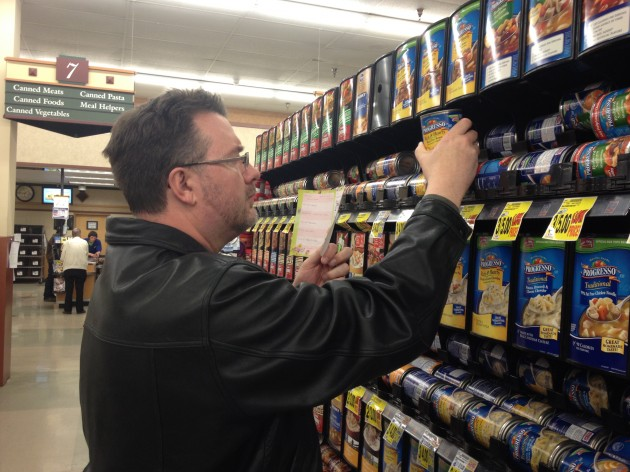 Todd using shopping list to buy soup