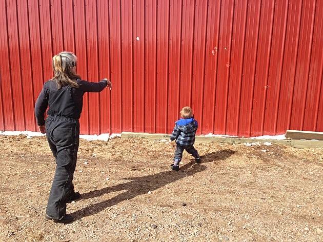 zander and susan throwing snowballs