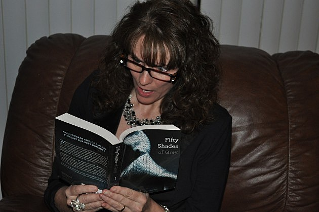 """Jenny Harding uses lighted goggles to read """"50 Shades of Grey"""""""