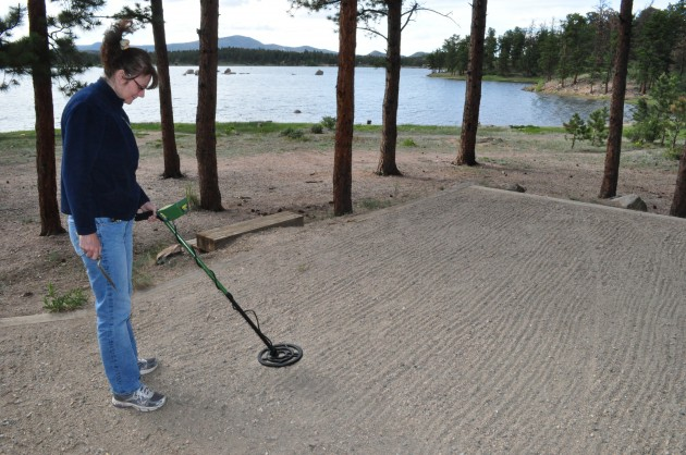 Todd Harding's wife Jenny using metal dectory at Dowdy Lake, CO