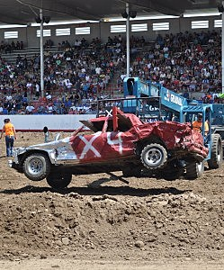 Car gets carried out of arena at 2013 Greeley Stampede Demo Derby
