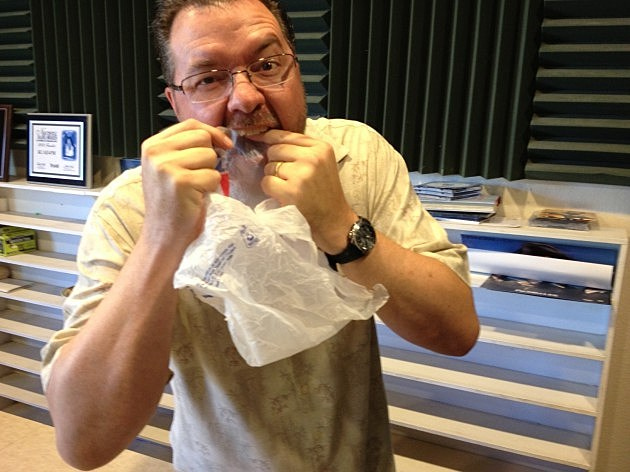 Todd Harding using a plastic grocery sack as Dental Floss