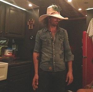 Jake Owen on his bus wearing his crazy hat