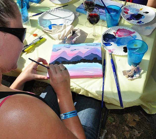 Sip N' Paint  at WineDown The Summer- Woman painting picture