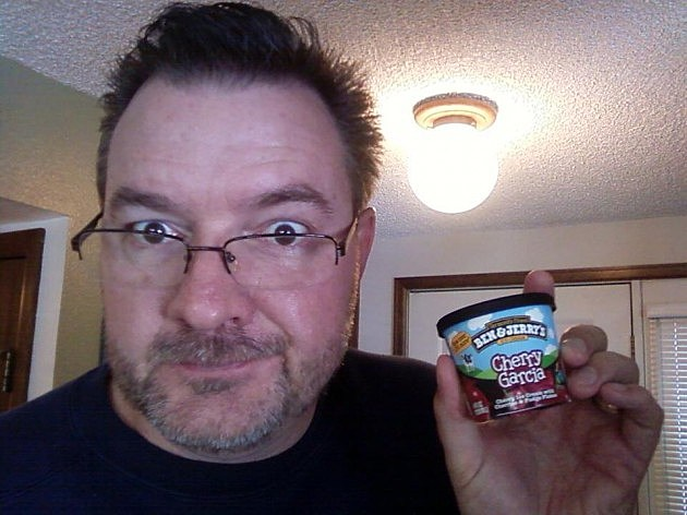 Todd holding tiny tub of Cherry Garcia