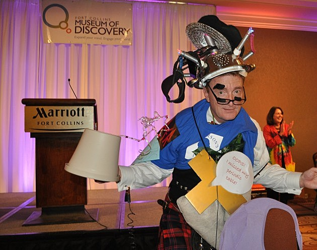 Host Mike Nelson wearing something from every team's costume at Brainiac Bowl
