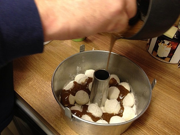 Pouring butter, brown sugar, cinnamon mixture over the top