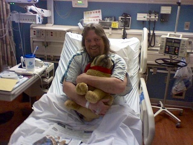 Brian after heart attack with stuffed dog