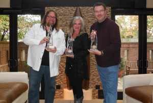 Brian, Susan, and Todd holding their CMA Awards