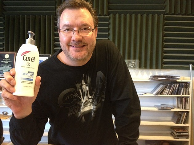 Todd holding lotion