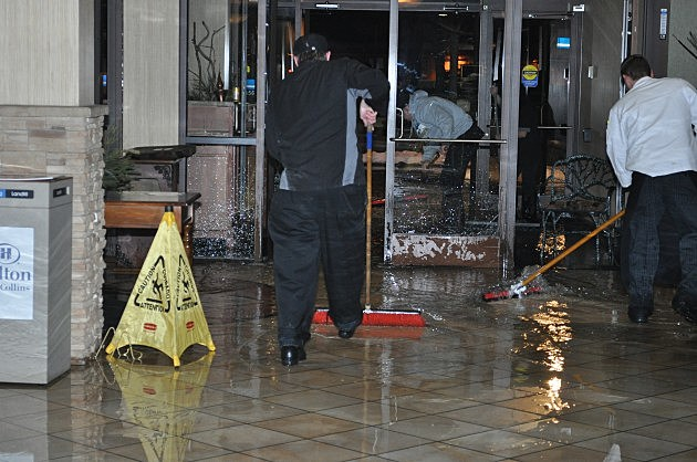 Pushing Water out of Fort Collins Hilton after pipes broke Friday night