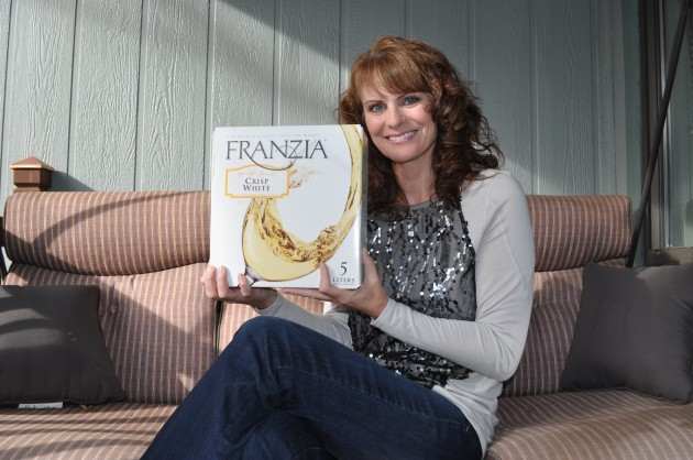 Jenny Harding with Box of Franzia Crisp White Wine