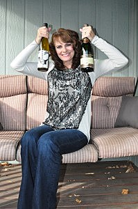 Jenny Harding with bottles of Kung Fu Girl Riesling and Segura Viudas Brut