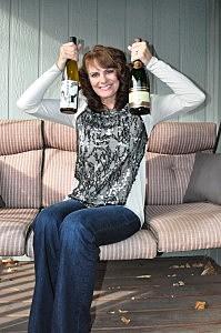 Jenny Harding with bottles of Kung Fu Girl Riesling and Segura Viudas Brut