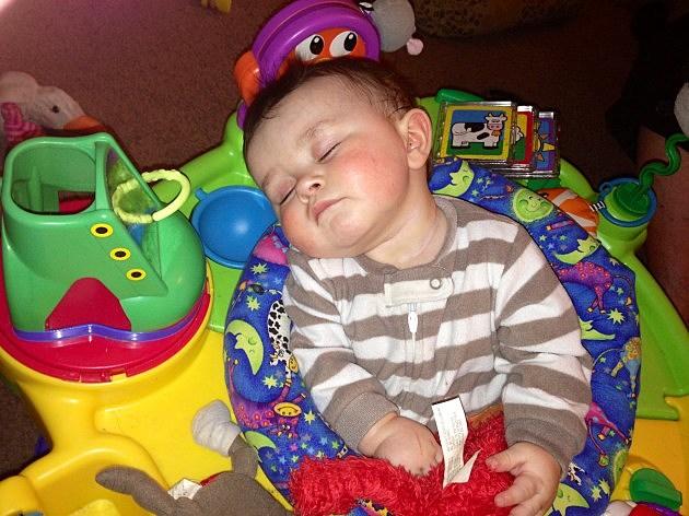 zayden sleeping in bouncy seat