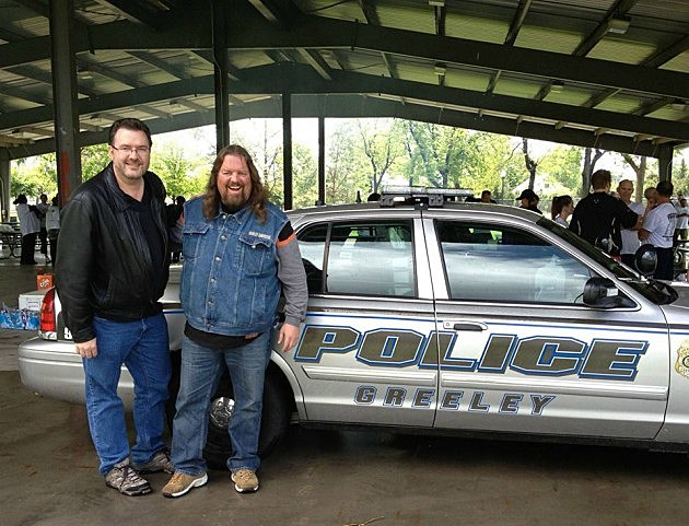 Brian & Todd with Greeley Police Car at 2013 Law Enforcement Torch Run