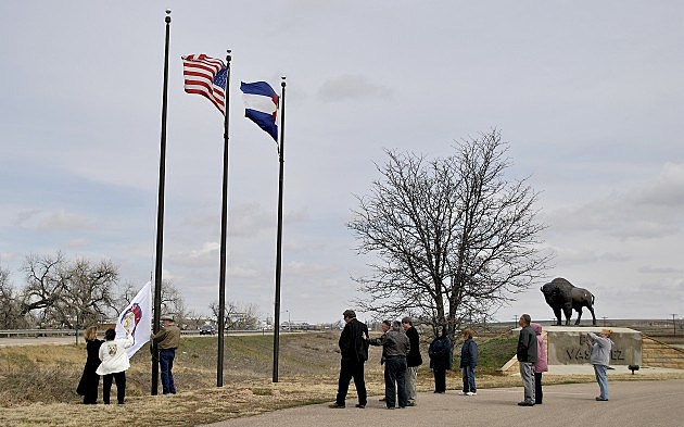 Weld County Flag being raised over Fort Vasquez