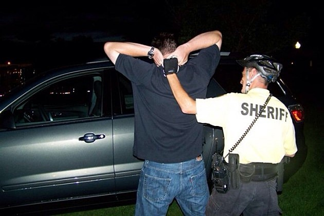 Sheriff's Deputy showing Todd an arrest technique