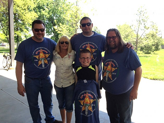 Todd, Special Olympics Director Jan Radnoti,  Greeley Police Officer DanielFrazen & his son, and Brian