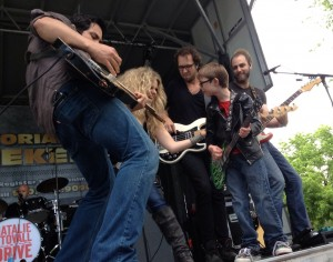 Natalie Stovall and the Drive pull kid on stage at Realities Ride 2014