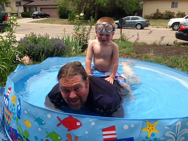 zander and papa in the pool