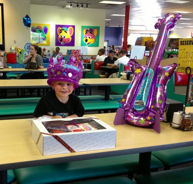zander with birthday cake and guitar