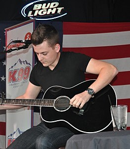 Chase Bryant tuning guitar at Boot Grill for New From Nashville Series