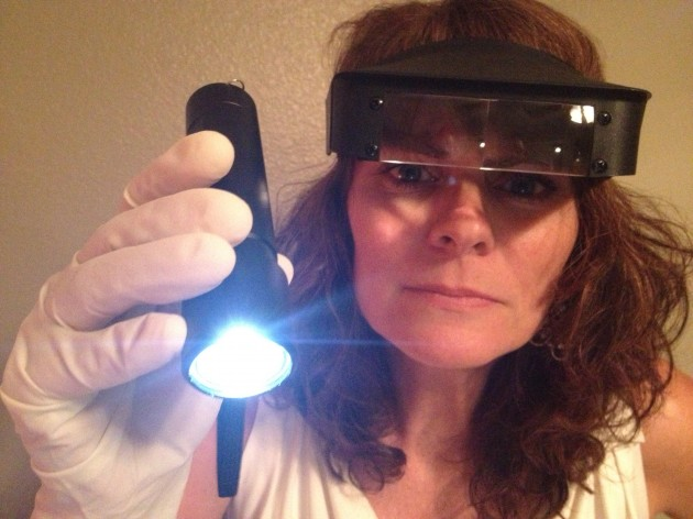 Jenny Harding with Magna-Visor, rubber gloves, and flashlight