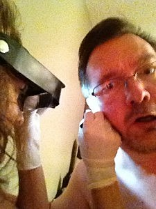 Todd's wife examines his ear