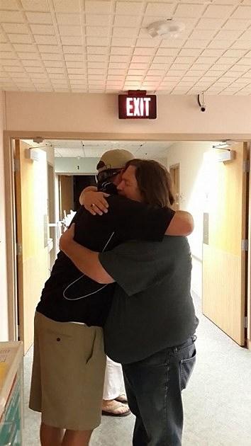 Nick and Dad hugging