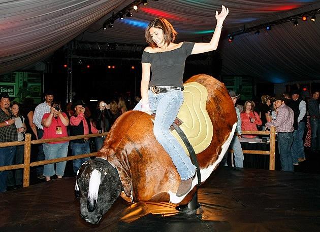 Hot girl riding bull