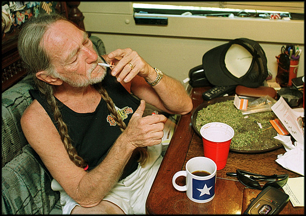 Willie Nelson smoking a little pot - Photo from Getty Images