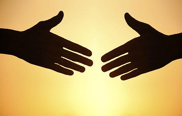 handshake at sunset