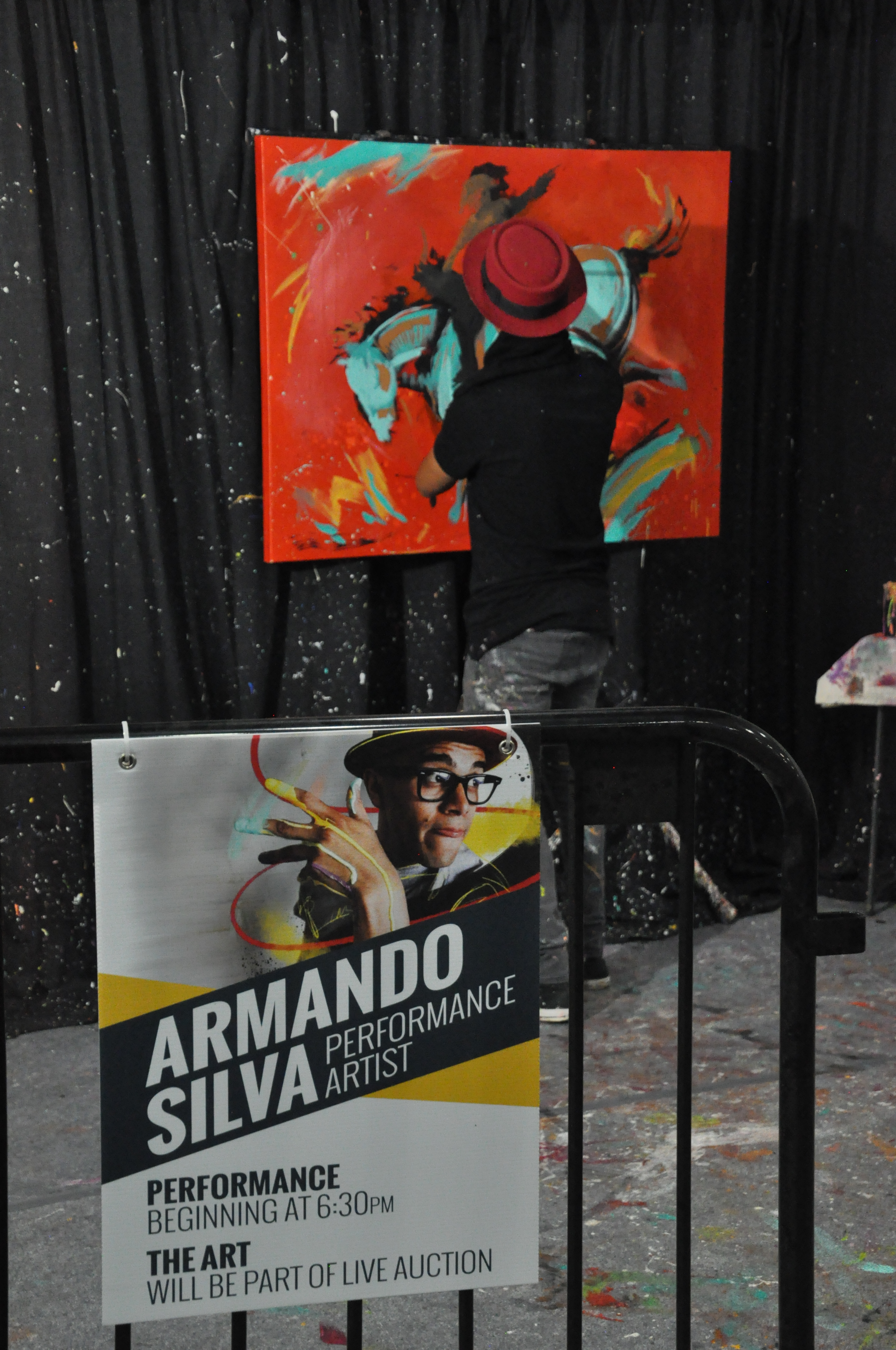 Armando Silva creates painting for Big Buckle Ball Live Auction